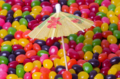 Jelly Bean beach with umbrella Royalty Free Stock Image