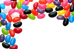 Jelly Bean Border. A border of colorful jelly beans, isolated on white royalty free stock images