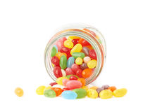 Jelly bean candies spilled out of jar Stock Photography