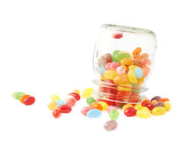 Jelly bean candies spilled out of jar Stock Image