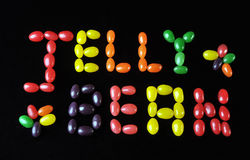 Jelly Bean candy. Jelly Bean written with a variation of jelly beans on a black background Royalty Free Stock Photo