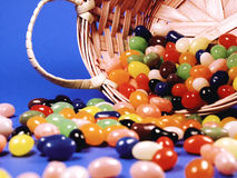 Jelly Bean Spill. Spilled Jelly Beans from an Easter Basket Stock Photography