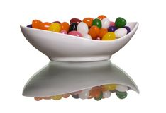 Jelly Beans. Colorful jelly beans in a white bowl, isolated on white with refection Stock Images
