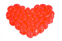 Jelly Beans. Shaped in a heart isolated on white stock photo