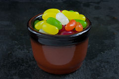 Jelly Beans. A bowl of jelly beans on a slate background Stock Images