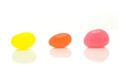 Jelly beans. Three jelly beans on white background Stock Image