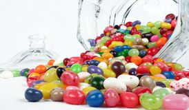 Jelly Beans. With a candy dish on a white background Royalty Free Stock Photography