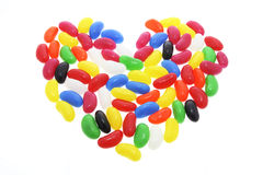 Jelly Beans Arranged in Shape of Love Heart Stock Photos