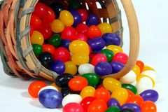 Jelly beans and basket close-up. Close-up of jelly beans and basket on light background Stock Photo