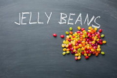 Jelly beans on chalkboard Stock Photography
