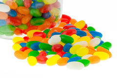 Jelly beans. Close up of jellybean sweets in a jar on an isolated white background Stock Images