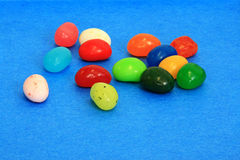 Jelly beans. Colorful jelly beans on blue background Royalty Free Stock Photo