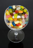 Jelly Beans in a glass!. A glass full of jelly bean sweets on a black background Royalty Free Stock Photo