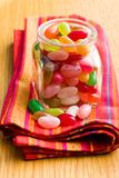 Jelly beans in glass jar Stock Images