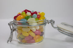 Jelly beans in glass jar Royalty Free Stock Images