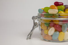 Jelly beans in glass jar Stock Photos