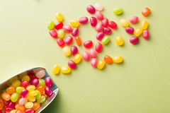 Jelly beans on green table Stock Image
