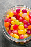 Jelly beans in jar Royalty Free Stock Image