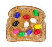 Jelly beans on peanut butter on bread Royalty Free Stock Photography