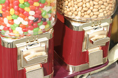 Jelly beans and peanuts. Dispensers royalty free stock image