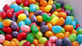 Jelly Beans Poured Into Bowl stock footage
