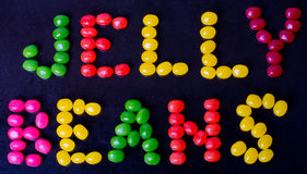 Jelly Beans sign on black Royalty Free Stock Images