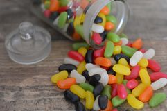 Jelly beans on a wooden backgroud. Jelly bean candy waiting to be eaten on a wooden backgroud royalty free stock photography