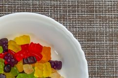 Jelly bear Marmalade closeup background. Colored jelly marmalade bears on a white plate and mat2 royalty free stock image
