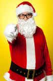 Jelly-belly Santa in spectacles pointing at you Stock Images