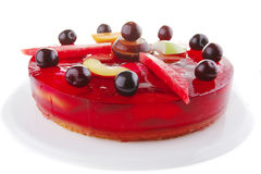 Jelly cake and cherry Royalty Free Stock Photography