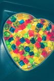 Jelly cake in the form of a heart with multi-colored cubes in the middle. The cake is being prepared.  stock image