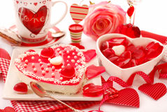 Jelly cake for valentine. Heart shaped cheese cake with jelly on the table with valentine`s decoration royalty free stock photography