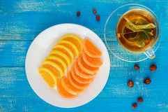 Jelly candies in form citrus slices covered with sugar and a cup of tea with a linden Royalty Free Stock Photos