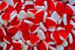 Jelly candies in the form of heart. Red and white background of sweets royalty free stock photography