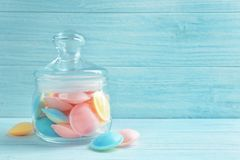 Jelly candies in glass jar. On wooden background Stock Images