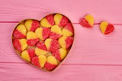 Jelly candies in heart shaped box. Group of colorful hearts in a heart shaped box and copy space, top view. Happy Valentines Day Royalty Free Stock Image