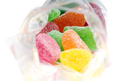 Jelly candy. Fruit jelly candies in transparent bag, on white background stock photos