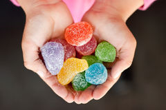 Jelly candy in child hands Royalty Free Stock Image