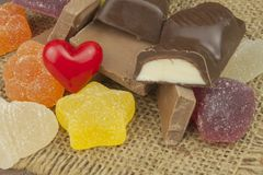 Jelly candy and chocolate on the tablecloth. Sweets for children Royalty Free Stock Photography