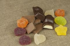 Jelly candy and chocolate on the tablecloth. Sweets for children Stock Photography