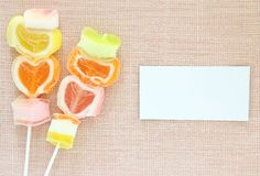 Jelly candy stick and white paper label Royalty Free Stock Photos