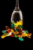 Jelly candy and wine glass on a dark background Stock Photo