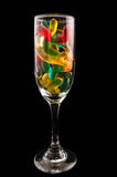 Jelly candy and wine glass on a dark background Stock Image