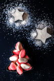 Jelly Christmas tree and sugar stars in the forms for biscuits top view Royalty Free Stock Photo