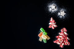 Jelly Christmas trees and sugar stars in the forms for biscuits horizontal Stock Photos