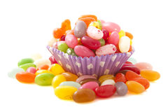 Jelly cup. Purple cup filled with lots of jelly beans royalty free stock image