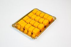 Jelly cupcakes in a tray on white background. Jelly cupcakes in a gold tray on white background royalty free stock image