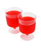 Jelly Cups. Two cups of red jelly isolated in white background Royalty Free Stock Photos