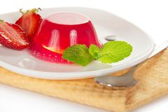 The jelly, decorated with strawberry and mint Royalty Free Stock Images