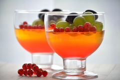 Jelly dessert with fruits. Jelly desserts with currants and grapes stock photos